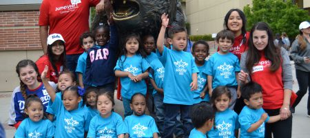 Preschoolers from some of the schools served by Jumpstart UCLA gather for a quick photo with the Bruin Bear