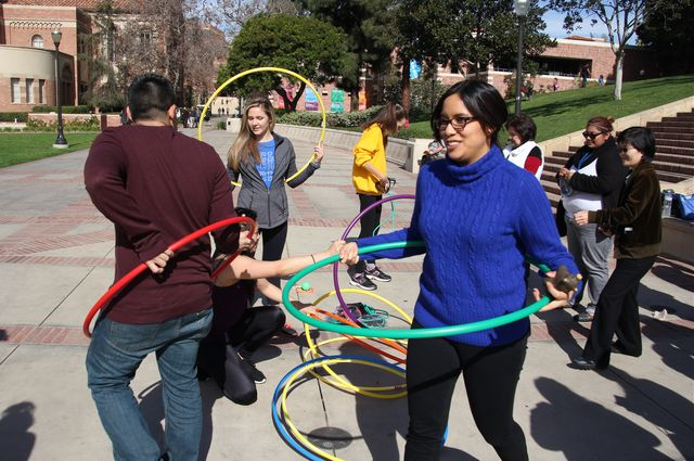 a picture of health people with hula hoops
