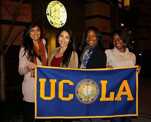 students holing UCLA banner